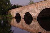 stock photo of tame  - Stone bridge spanning the River Tame in Tamworth - JPG