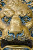 foto of lions-head  - Mailbox shaped as a lion head roaring with a fierce expression - JPG