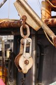 picture of pulley  - Old and crusty pulley on the deck of an old rusty fishing boat - JPG