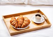 stock photo of bed breakfast  - breakfast in bed with coffee and croissants - JPG