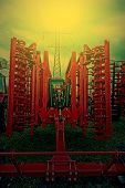 foto of cultivator-harrow  - Agricultural equipment in sunset light - JPG