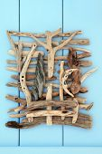 foto of driftwood  - Driftwood abstract design on wooden blue background - JPG