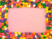 picture of jelly beans  - Frame and background made of colorful jelly beans - JPG