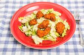 image of caesar salad  - A fresh caesar salad topped with spicy buffalo chicken nuggets - JPG