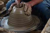 stock photo of molding clay  - potter making a clay pot in thailand  - JPG