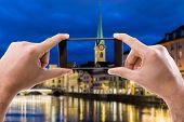 foto of zurich  - Hand holding Smartphone in Zurich - JPG