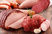 foto of slaughterhouse  - Assorted meat products including ham and sausages.