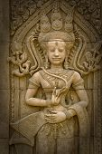picture of stone sculpture  - Apsara sculptures at Angkor Watdetail of stone carvings - JPG