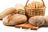 image of bread rolls  - Composition with bread and rolls in wicker basket isolated on white - JPG