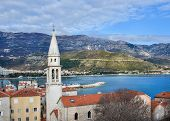 picture of red roof tile  - The view over the old town center of Budva Montenegro the chapel red tiled roofs and Adriatic sea coast from the citadel wall - JPG