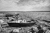 stock photo of boat  - Old fishing motor boat on lake coast in Karelia - JPG