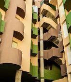 picture of high-rise  - Colorful high rise building facade with curved lines - JPG