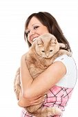 image of young woman posing the camera  - Young woman posing at camera with redhaired domestic cat - JPG