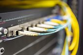 picture of utp  - Optical switch and colorfull FC cables connected equipment in data center - JPG