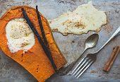 picture of vanilla  - Backed pumpkin half with a scoop of vanilla ice - JPG