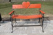foto of pews  - lace decorated bench with heart on back in park called  - JPG