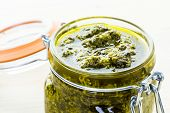 stock photo of pesto sauce  - Homemade basil pesto sauce with fresh ingredients.