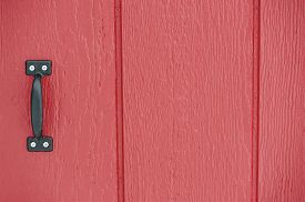 pic of red siding  - Rustic red barn door background with black handle - JPG