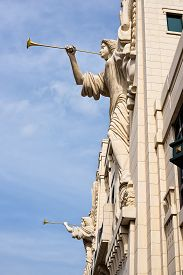 pic of angel-trumpet  - Two angel sculptures with trumpet horns on the front facade of the Bass Performance Hall in Fort Worth TX - JPG
