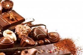 stock photo of bonbon  - Chocolates border isolated on white background - JPG