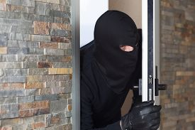 stock photo of raider  - Thief entering a private home to steal - JPG