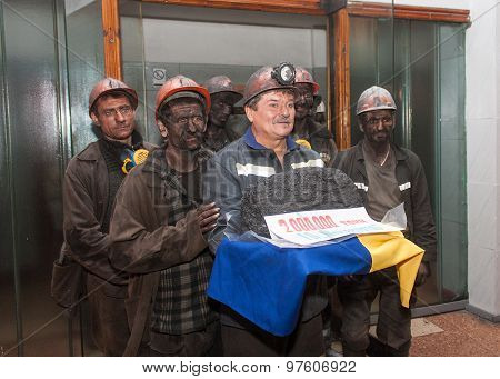 Makeevka, Ukraine - November 26, 2013: Miners With Coal Symbolic Ingot At The Ceremony In Honor Of 2