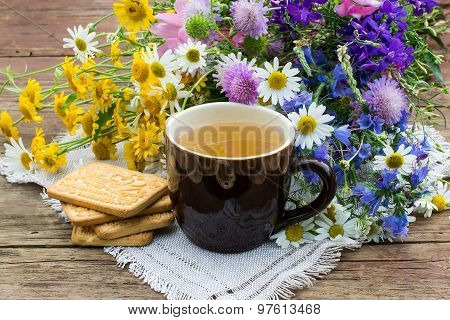 Flower Tea, Cookies And A Bouquet Of Wildflowers