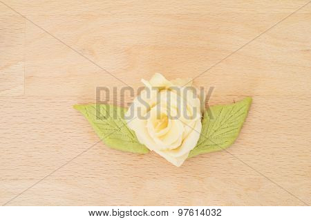 Rose made with japanese sushi ginger on wooden background
