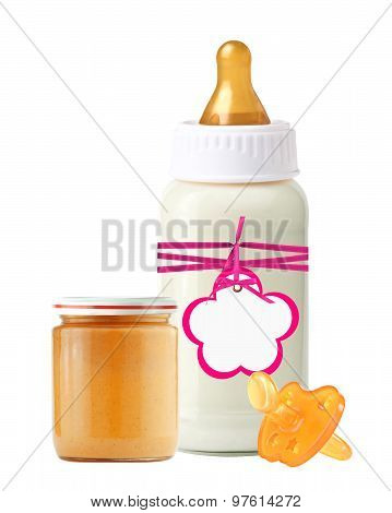 Jar Of Baby Puree, Baby Milk Bottle With Pink Tag And Dummy Isolated On White