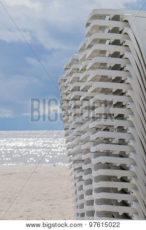 Stacked Sun Loungers On The Beach Before Storm