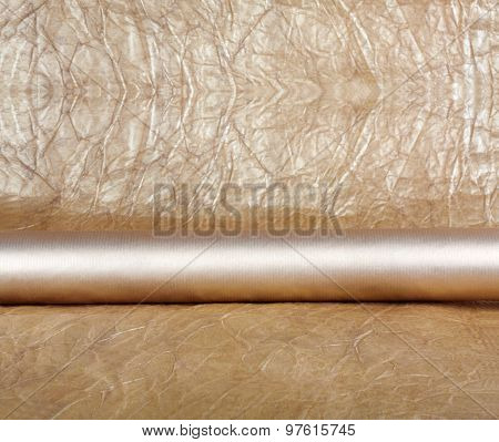 Rolls Of Golden Wrapping Paper For Gifts On Abstract Background.