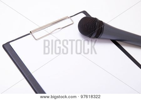 Speech Or Interview Concept - Microphone And Clipboard With Blank Paper