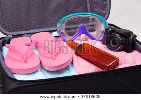 Vacation Concept - Packed Suitcase Full Of Vacation Items