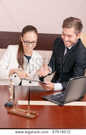 Nice lawyer talking with colleague