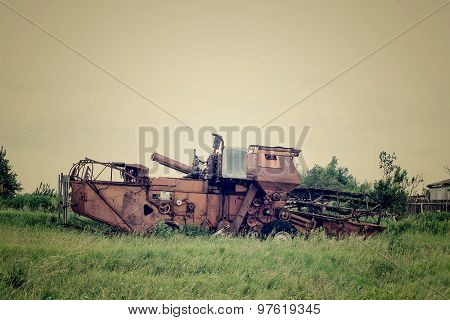 Old Harvester Abandoned In The Grass