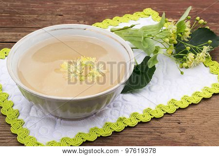 A Cup Of Freshly Brewed Tea With Lime Blossom