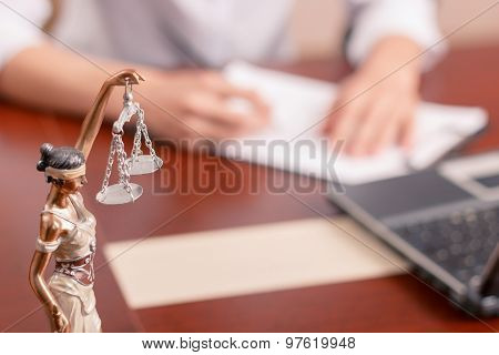 Professional lawyer signing documents