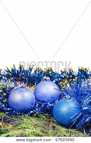 Blue Christmas Baubles On Green Spruce Tree Branch