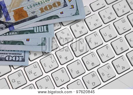 Close-up Of Dollar Cash  On The Computer Keyboard
