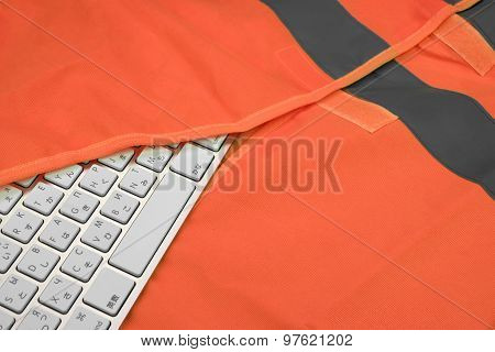 Keyboard In The Orange Reflective Safety Vest