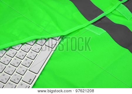 Keyboard In The Green Reflective Safety Vest