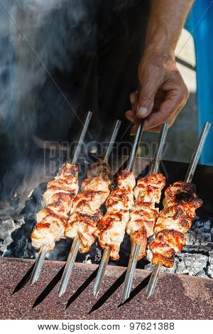 Chef Cooks Kebabs On Grill