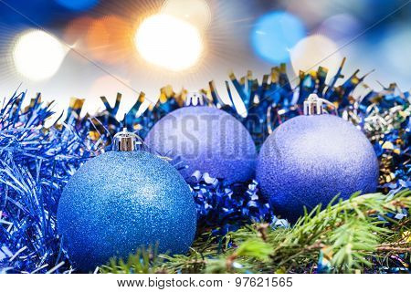 Christmas Blue Baubles On Blurred Blue Background