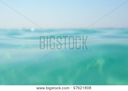 Clean turquoise sea wave close up. Natural sea beauty, soft focus.