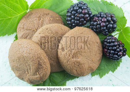 Integral Biscuits And Fresh Blackberries On Blackberry Leaves
