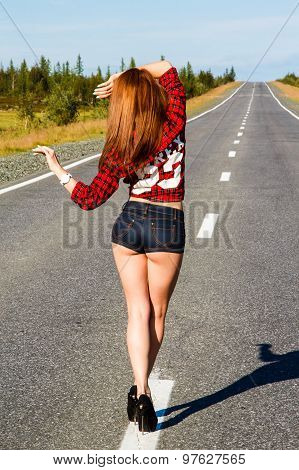 Woman In A Checked Shirt On The Road