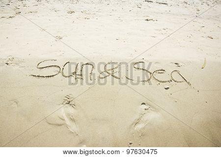 Sun And Sea Written In Sand
