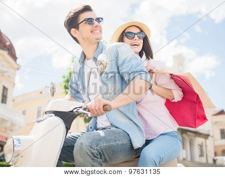 Young Couple On Scooter