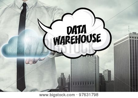 Data warehouse text on cloud computing theme with businessman