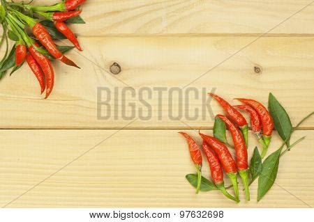 Freshly picked chili peppers on a wooden table. Preparation for the domestic processing of a crop.